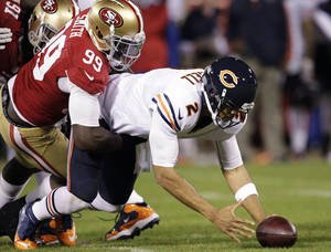 Photo -   Chicago Bears quarterback Jason Campbell (2) recovers his own fumble after being sacked by San Francisco 49ers linebacker Aldon Smith (99) during the second quarter of an NFL football game in San Francisco, Monday, Nov. 19, 2012. (AP Photo/Tony Avelar)