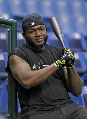 Photo - Boston Red Sox's David Ortiz watches his teammates take batting practice for Monday's Game 3 of baseball's American League division series against the Tampa Bay Rays Sunday, Oct. 6, 2013, in St. Petersburg, Fla. (AP Photo/Chris O'Meara)