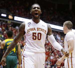 Photo - Iowa State guard DeAndre Kane reacts after making a basket during the first half of an NCAA college basketball game against Baylor, Tuesday, Jan. 7, 2014, in Ames, Iowa.   Kane scored 30 points as Iowa State won 87-72. (AP Photo/Charlie Neibergall)