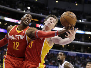 Photo - Houston Rockets' Dwight Howard, left, and Omer Asik, of Turkey, reach for a rebound during the first half of an NBA basketball game against the Los Angeles Clippers on Monday, Nov. 4, 2013, in Los Angeles. The Clippers won 137-118. (AP Photo/Jae C. Hong)