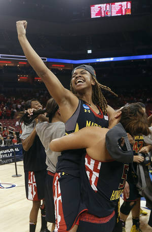 Photo - Maryland guard Sequoia Austin celebrates after Maryland defeated Louisville 76-73 in a regional final of the NCAA women's college basketball tournament Tuesday, April 1, 2014, in Louisville, Ky. (AP Photo/John Bazemore)