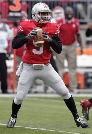 Photo - Ohio State quarterback Braxton Miller drops back to pass against Indiana during the first quarter of an NCAA college football game Saturday, Nov. 23, 2013, in Columbus, Ohio. (AP Photo/Jay LaPrete)