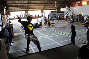Photo -   Recording artist Lil Wayne skates in a new skateboard park he helped finance along with Glu Agency and Mountain Dew, in the Lower Ninth Ward of New Orleans, Wednesday, Sept. 26, 2012. (AP Photo/Gerald Herbert)
