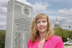 Photo - Cyndie Clubb's husband Terry, a state Transportation Department employee, was injured at a construction site and died the next day.  <strong>David McDaniel - The Oklahoman</strong>