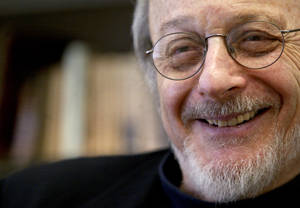 "Photo - FILE - In this April 27, 2004 file photo, author E.L. Doctorow smiles during an interview in his office at New York University. The Prague Writers' Festival opens in Pittsburgh on Friday, Oct. 18, 2013, the first time the event is being held in the United States. E.L. Doctorow, known for works including ""Ragtime"" and ""Billy Bathgate, is slated to read excerpts of his new novel, ""Andrew's Brain,"" at the festival. (AP Photo/Mary Altaffer, File)"