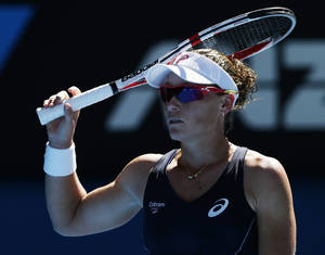 Photo - Australia's Samantha Stosur rests her racket on her head during her second round match against China's Zheng Jie at the Australian Open tennis championship in Melbourne, Australia, Wednesday, Jan. 16, 2013. (AP Photo/Andy Wong)