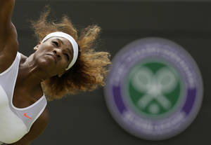 Photo - ADVANCE FOR WEEKEND EDITIONS, JUNE 21-22 - FILE - In this June 27, 2013, file photo, Serena Williams, of the United States, serves to Caroline Garcia, of France, during their women's second-round singles match at the All England Lawn Tennis Championships in Wimbledon, London. Williams is ranked No. 1 and seeded No. 1 at Wimbledon, where she has won the title five times. (AP Photo/Alastair Grant, File)