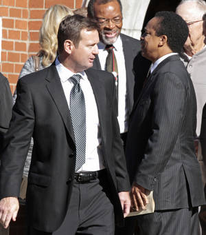 Photo - University of Oklahoma head football coach Bob Stoops leaves funeral services for Bob Barry Sr. at St. John's Episcopal Church on Thursday, Nov. 3, 2011, in Norman, Okla.  Behind him is former player Dewey Selmon.  Photo by Steve Sisney, The Oklahoman ORG XMIT: KOD