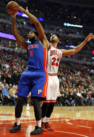 Photo - Detroit Pistons center Andre Drummond (0) tries to protect the ball away from Chicago Bulls forward Taj Gibson (22) during the first half of an NBA basketball game in Chicago, Saturday, Dec. 7, 2013. (AP Photo/Kamil Krzaczynski)