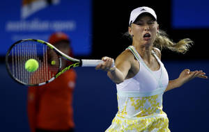 Photo - Caroline Wozniacki of Denmark hits a forehand return to Christina McHale of the U.S. during their second round match at the Australian Open tennis championship in Melbourne, Australia, Thursday, Jan. 16, 2014.(AP Photo/Aaron Favila)