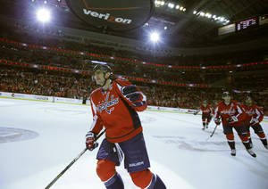 Photo - Washington Capitals right wing Alex Ovechkin, of Russia, celebrates after his goal in the first period of an NHL hockey game against the Tampa Bay Lightning, Tuesday, Dec. 10, 2013, in Washington. (AP Photo/Alex Brandon)