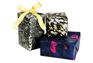 Photo - This product image released by One Kings Lane shows gift-wrapped boxes with paper designed by stylist-designer Rachel Zoe. Zoe is among the tastemakers that partnered with the site for the One Kings Lane Holiday Charity Series. (AP Photo/One Kings Lane) <strong> - AP</strong>
