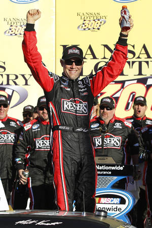 Photo - Matt Kenseth celebrates his victory in the NASCAR Nationwide Series auto race at Kansas Speedway in Kansas City, Kan., Saturday, Oct. 5, 2013. (AP Photo/Colin E. Braley)