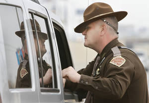 photo -  Oklahoma Highway Patrolman Mike Moler talks with a motorist Jan. 25 on I-240 in Oklahoma City. Photo By Steve Gooch, The Oklahoman