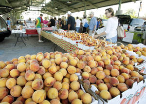 Photo - Edmond residents look at Oklahoma-grown produce at Edmond's Farmers Market in 2012.
