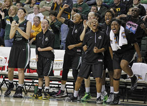Photo - Wright State Raiders players react to their team taking the lead against Green Bay during the first half of an NCAA college basketball game for the Horizon League tournament championship on Sunday March 16, 2014, in Green Bay, Wis. (AP Photo/Matt Ludtke)