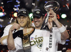 Photo - Green Bay Packers' Aaron Rodgers, right, and teammate Clay Matthews celebrate after the Packers' 31-25 win over the Pittsburgh Steelers in the NFL Super Bowl XLV football game Sunday, Feb. 6, 2011, in Arlington, Texas. Rodgers was named most valuable player of the game. (AP Photo/Chris O'Meara)