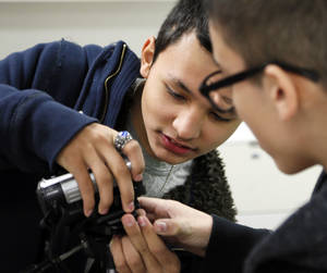 Photo - Eighth-graders Maddux Wolfinbarger, left, and Kaleb Brewer set up a camera to record a video for Victor Rook's computer education class Nov. 21 at Central Junior High in Moore. Photo by Nate Billings, The Oklahoman <strong>NATE BILLINGS</strong>