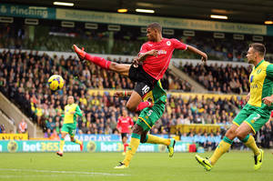 Photo - Cardiff City's Fraizer Campbell stretches for the ball during the English Premier League soccer match between Norwich City and Cardiff City at Carrow Road, Norwich, England, Saturday, Oct. 26, 2013. (AP Photo/Chris Radburn, PA Wire)  UNITED KINGDOM OUT  -  NO SALES  -  NO ARCHIVES