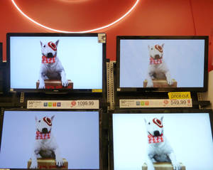 Photo -   In this Feb. 20, 2012 photo, flat screen televisions are displayed at Target in Methuen, Mass. Target Corp. is reporting a 5.2 percent drop in earnings for the fourth quarter, as the discounter pushed big discounts to get tight-fisted shoppers to buy during the holiday season. (AP Photo/Elise Amendola)