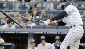 Photo -   New York Yankees Alex Rodriguez breaks a bat grounding out in the fifth inning of play against the Seattle Mariners on Saturday, May 12, 2012 in New York. The Yankees won the baseball game 6-2. (AP PhotoPeter Morgan)