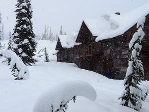 Photo - A photo provided by Glacier National Park shows the Sperry Chalet in Glacier National Park, Mont., Wednesday June 18, 2014.   National Weather Service  employees at Sperry Chalet report 14-16 inches of snow since Tuesday, June 17, 2014 morning. Tourists hunkered down in lodges, snow plowing crews stood down, and park officials were preparing for possible employee evacuations from the St. Mary area. (AP Photo/ Denise Germann)