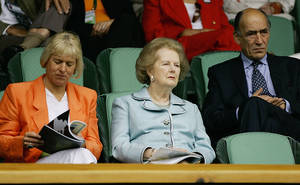 Photo - FILE - In this July 2, 2005, file photo, former British Prime Minister Margaret Thatcher, center, watches a seminfinal between Andy Roddick and Thomas Johansson on Centre Court at Wimbledon. At left is Thatcher's daughter Carol Thatcher and at right is General Sir Mike Jackson. The office of prime minister changed hands 16 times between Wimbledon titles for Fred Perry and Andy Murray. (AP Photo/Anja Niedringhaus, File)