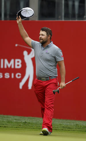 Photo - Ryan Moore of the U.S. acknowledges the crowd after winning in a playoff of the CIMB Classic golf tournament at the Kuala Lumpur Golf and Country Club in Kuala Lumpur, Malaysia, Monday, Oct. 28, 2013. (AP Photo/Lai Seng Sin)