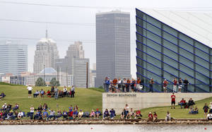 Photo - A crowd watches April 28 from the shoreline of the Oklahoma River during the Big 12 Rowing Championships in Oklahoma City.  Photo by Bryan Terry,  The Oklahoman