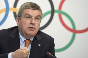 "Photo - International Olympic Committee, IOC, President German Thomas Bach, speaks during a press conference after an executive board meeting, at the IOC headquarters, in Lausanne, Switzerland, Wednesday, July 9, 2014. Brazilian Olympic organizers are benefiting from the successful hosting of the World Cup and showing ""great dynamism"" to overcome the delays that have plagued the 2016 Games in Rio de Janeiro, Bach said. (AP Photo/Keystone, Jean-Christophe Bott)"