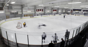 Photo - In this image taken with a slow shutter speed, Buffalo Sabres players skate during NHL hockey practice in Amherst, N.Y., Tuesday, Jan. 8, 2013. (AP Photo/David Duprey)