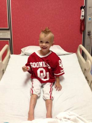 Photo -  McKoy Beard, 2, smiles in his hospital bed at The Children's Hospital at OU Medical Center, where he receives treatment for kidney cancer. PHOTO PROVIDED  <strong> Photo provided.   -  Photo provided.  </strong>
