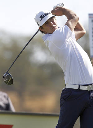 Photo - Brooks Koepka hits from the second tee during the third round of the Frys.com Open golf tournament, Saturday, Oct. 12, 2013, in San Martin, Calif. (AP Photo/Tony Avelar)