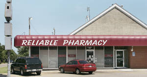 Photo - An Oklahoma County judge ended a temporary order that had required a national company to continue shipping to Reliable Discount Pharmacy, shown at left. The pharmacy was in the national spotlight in 2009 after an employee, Jerome Ersland, above, fatally shot a robber there. Ersland was convicted last year of first-degree murder. OKLAHOMAN ARCHIVE PHOTOS
