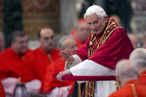 photo -   Pope Benedict XVI makes his way through cardinals as he arrives inside St. Peter's Basilica at the Vatican to preside over a consistory, Saturday, Nov. 24, 2012. Six new cardinals are joining the elite club of churchmen who will elect the next pope, bringing a more geographically diverse mix into the European-dominated College of Cardinals. The new cardinals are: Archbishop James Harvey, the American prefect of the papal household; Abuja, Nigeria Archbishop John Olorunfemi Onaiyekan; Bogota, Colombia Archbishop Ruben Salazar Gomez; Manila, Philippines Archbishop Luis Antonio Tagle; Patriarch of Antioch of the Maronites in Lebanon, His Beatitude Bechara Boutros Rai; and the major Archbishop of the Trivandrum of the Siro-Malankaresi in India, His Beatitude Baselios Cleemis Thottunkal. (AP Photo/Andrew Medichini)