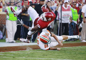Photo -   Oklahoma wide receiver Justin Brown (19) is tripped up by Florida A&M's Branden Holdren (86) short of the goal line during the first quarter of an NCAA college football game in Norman, Okla., Saturday, Sept. 8, 2012. (AP Photo/Sue Ogrocki)