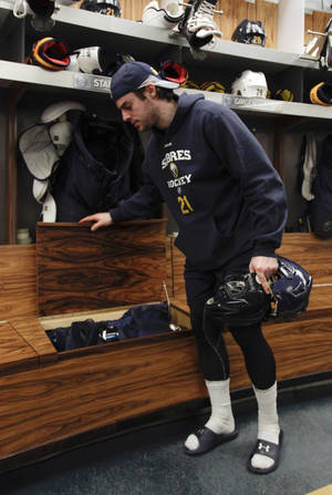 Photo - Buffalo Sabres right wing Drew Stafford cleans out his locker on Monday, April 14, 2014, after the NHL hockey team clinched the NHL's worst record, in Buffalo, N.Y. (AP Photo/Nick LoVerde)