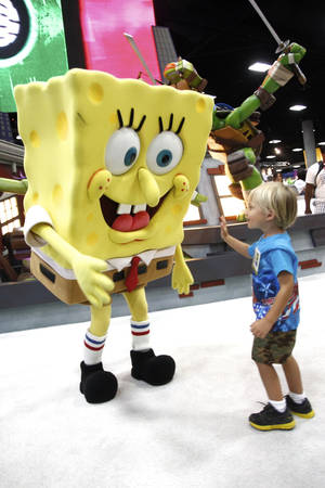 Photo -   FILE - In this July 15, 2012 publicity photo provided by Nickelodeon, a fan is seen with SpongeBob SquarePants during Comic-Con, in San Diego, Calif. Storm Troopers, cyborgs, superheroes and other comic-book fans can count on their annual pilgrimage to San Diego for another four years. San Diego Mayor Jerry Sanders announced Monday, Oct. 29, 2012, that Comic-Con has extended its contract with the city through 2016. (AP Photo/Nickelodeon, Joe Kohen, File)