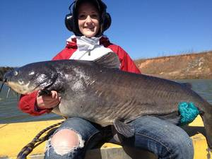photo - Jessie Roberts, 16, from Sterling, Kan., landed a 90-pound blue catfish while fishing with guide Norman O'Neal Monday on the Red River. The fish was caught 10 miles below the Denison Dam on the Red River with the water falling after generation, O'Neal said. PHOTO PROVIDED