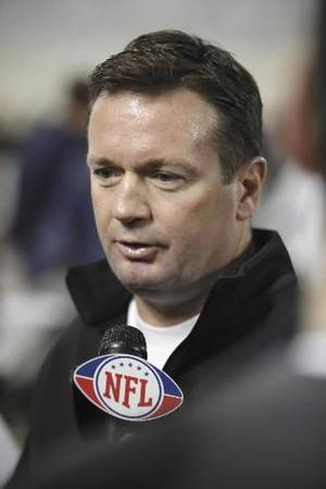 Photo - Head football coach  Bob  Stoops speaks to the media as Sooner football players go through various tests for NFL scouts at the Everest Indoor Practice Facility at the University of Oklahoma on Tuesday, March 9, 2010, in Norman, Okla. Photo by Steve Sisney