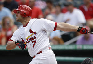 Photo - St. Louis Cardinals' Matt Holliday watches his double in the third inning of a spring training baseball game against the Miami Marlins in Jupiter, Fla., Sunday, March 18, 2012. Daniel Descalso scored on the play. (AP Photo/Patrick Semansky) ORG XMIT: FLPA106