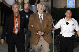 Photo -   Former Penn State University assistant football coach Jerry Sandusky, center, leaves the Centre County Courthouse in custody with Centre County Sheriff Denny Nau, left, after being found guilty of multiple charges of child sexual abuse in Bellefonte, Pa., Friday, June 22, 2012. Sandusky was convicted of sexually assaulting 10 boys over 15 years, accusations that had sent shock waves through the college campus known as Happy Valley and led to the firing of Penn State's beloved Hall of Fame coach, Joe Paterno. (AP Photo/Gene J. Puskar)