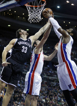 Photo - Brooklyn Nets forward Mirza Teletovic (33), Detroit Pistons forward Josh Harrellson (55) and center Andre Drummond (0) try to grab a rebound during the first half of an NBA basketball game on Friday, Dec. 13, 2013, in Auburn Hills, Mich. (AP Photo/Duane Burleson)
