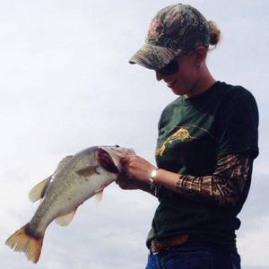 Photo - Brooke Bean, a UCO student and member of the school's bass fishing club, holds a fish that she caught in a recent collegiate tournament. UCO started a bass fishing club this semester and it already has 75 members. <strong>Photo provided</strong>