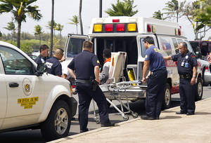 """Photo - A 15-year-old boy, seen sitting on a stretcher center, who stowed away in the wheel well of a flight from San Jose, Calif., to Maui is loaded into an ambulance at Kahului Airport in Kahului, Maui, Hawaii Sunday afternoon, April 20, 2014. The boy survived the trip halfway across the Pacific Ocean unharmed despite frigid temperatures at 38,000 feet and a lack of oxygen, FBI and airline officials said. FBI spokesman Tom Simon in Honolulu told The Associated Press on Sunday night that the boy was questioned by the FBI after being discovered on the tarmac at the Maui airport with no identification. """"Kid's lucky to be alive,"""" Simon said. (AP Photo/The Maui News, Chris Sugidono)"""