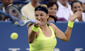 Photo -   Victoria Azarenka, of Belarus, returns a shot to Anna Tatishvili, of Georgia, in the fourth round of play at the U.S. Open tennis tournament, Sunday, Sept. 2, 2012, in New York. (AP Photo/Henny Ray Abrams)