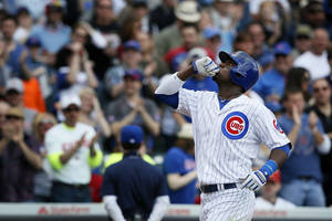 Photo - Chicago Cubs' Junior Lake celebrates after hitting a two-run home run during the sixth inning of a baseball game against the St. Louis Cardinals on Saturday, May 3, 2014, in Chicago. (AP Photo/Andrew A. Nelles)