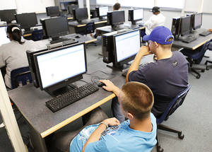 photo - High school students study at computers during a weeklong summer camp at Star Spencer High School to prepare students for end-of-Instruction tests. By Paul Hellstern, The Oklahoman Archives