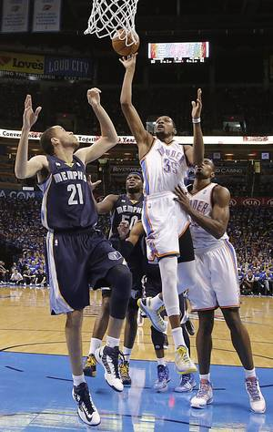 Photo - Oklahoma City's Kevin Durant (35) puts up a shot over Memphis' Tayshaun Prince (21) during the second round NBA playoff basketball game between the Oklahoma City Thunder and the Memphis Grizzlies at Chesapeake Energy Arena in Oklahoma City, Sunday, May 5, 2013. Photo by Chris Landsberger, The Oklahoman
