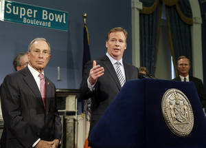 Photo - NFL Commissioner Roger Goodell ,right, speaks as and New York City Mayor Michael Bloomberg listens during a news conference to announce plans for the Super Bowl Thursday, Jan. 24, 2013, in New York.  (AP Photo/Frank Franklin II)